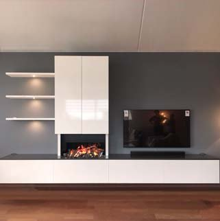 With an electric fireplace in combination with a TV/audio wall unit is durable and very cosy to have